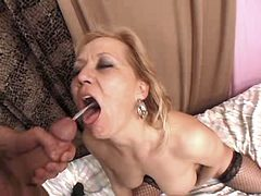 Mom gets cumshots in orgy