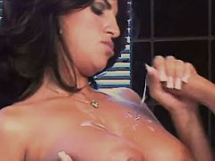 Brunette milf gets cumshot on tits