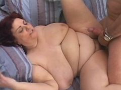 Fat mature gets cum on flabby belly